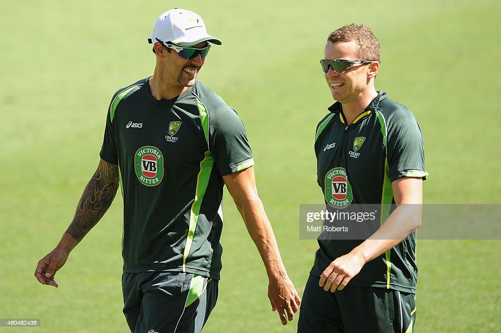 <a gi-track='captionPersonalityLinkClicked' href=/galleries/search?phrase=Mitchell+Johnson+-+Cricket+Player&family=editorial&specificpeople=665783 ng-click='$event.stopPropagation()'>Mitchell Johnson</a> and <a gi-track='captionPersonalityLinkClicked' href=/galleries/search?phrase=Peter+Siddle&family=editorial&specificpeople=2104718 ng-click='$event.stopPropagation()'>Peter Siddle</a> share a laugh during an Australian training session at The Gabba on December 15, 2014 in Brisbane, Australia.