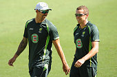 Mitchell Johnson and Peter Siddle share a laugh during an Australian training session at The Gabba on December 15 2014 in Brisbane Australia
