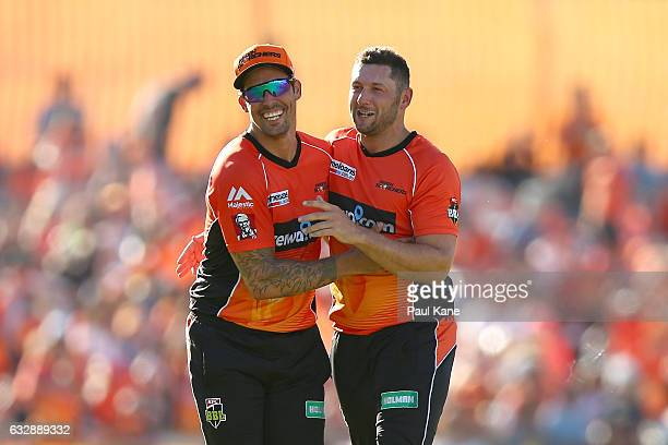 Mitchell Johnson and Tim Bresnan of the Scorchers celebrate the wicket of Johan Botha of the Sixers during the Big Bash League match between the...