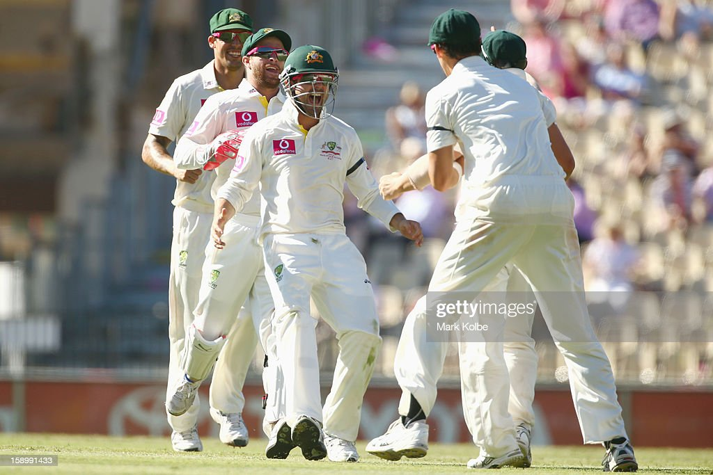 Mitchell Johnson, Matthew Wade and Ed Cowan of Australia run to congratulate David Warner of Australia after he ran out Angelo Mathews of Sri Lanka during day three of the Third Test match between Australia and Sri Lanka at Sydney Cricket Ground on January 5, 2013 in Sydney, Australia.