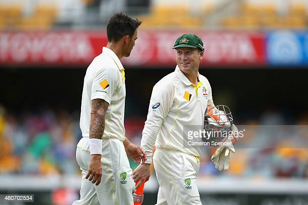 Mitchell Johnson of Australia and Brad Haddin of Australia leave the field after bowling India out in their first innings during day four of the 2nd...