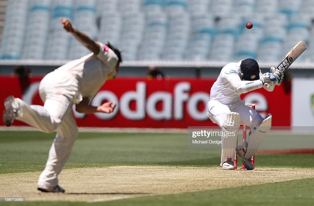 Mitchell Johnson of Australia bowls a bouncer to Kumar Sangakkara of Sri Lanka during day one of the Second Test match between Australia and Sri Lanka at Melbourne Cricket Ground on December 26, 2012 in Melbourne, Australia.