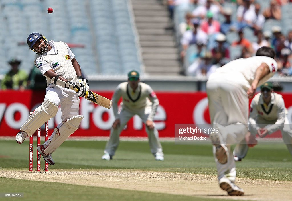 Mitchell Johnson of Australia bowls a bouncer to Rangana Herath of Sri Lanka during day three of the Second Test match between Australia and Sri Lanka at Melbourne Cricket Ground on December 28, 2012 in Melbourne, Australia.