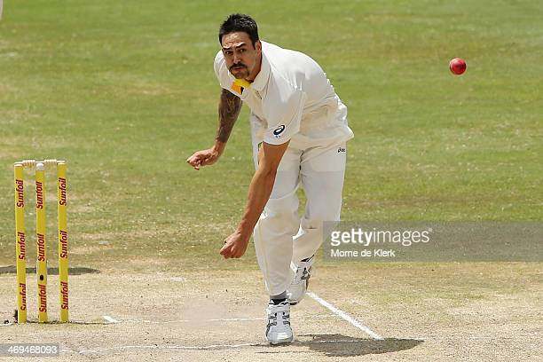 Mitchell Johnson of Australia bowls during day four of the First Test match between South Africa and Australia on February 15 2014 in Centurion South...