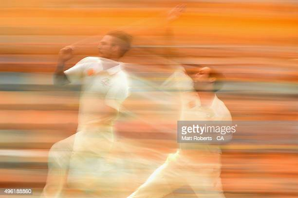 Mitchell Johnson of Australia bowls during day four of the First Test match between Australia and New Zealand at The Gabba on November 8 2015 in...