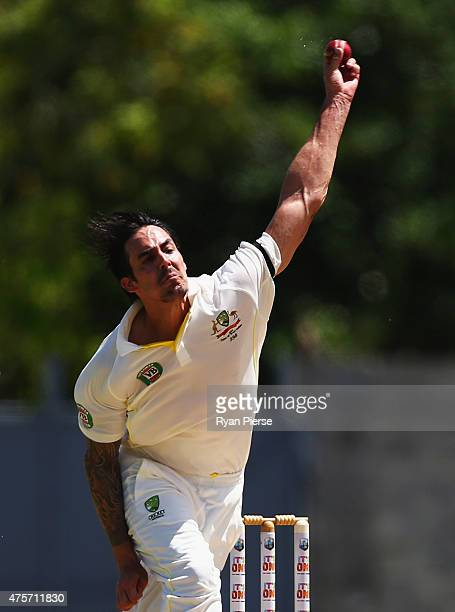 Mitchell Johnson of Australia bowls during day one of the First Test match between Australia and the West Indies at Windsor Park on June 3 2015 in...