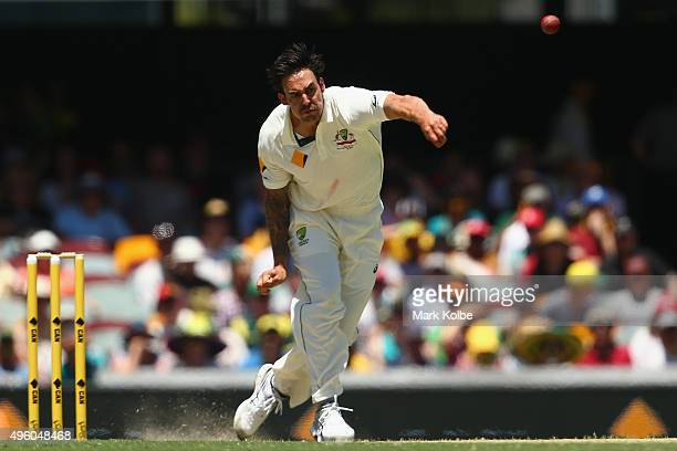 Mitchell Johnson of Australia bowls during day three of the First Test match between Australia and New Zealand at The Gabba on November 7 2015 in...
