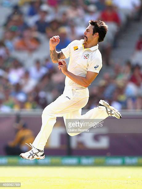 Mitchell Johnson of Australia bowls during day three of the Fourth Ashes Test Match between Australia and England at Melbourne Cricket Ground on...