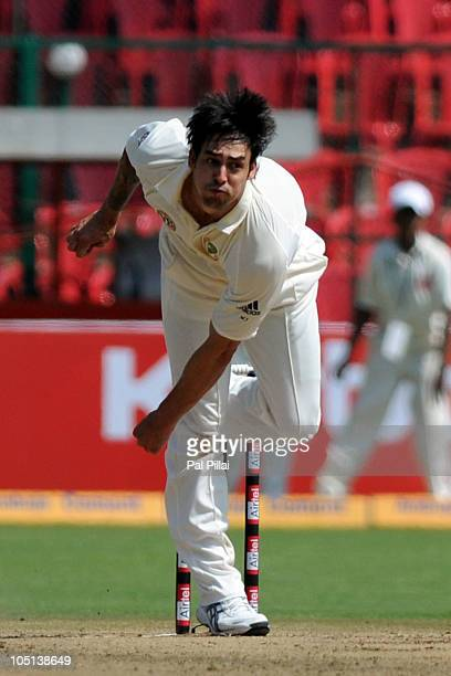 Mitchell Johnson of Australia bowls during day three of the Second Test match between India and Australia at MChinnaswamy Stadium on October 11 2010...