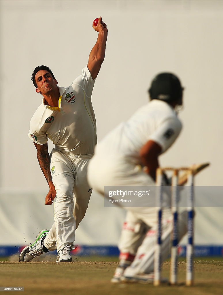 Mitchell Johnson of Australia bowls during Day Three of the Second Test between Pakistan and Australia at Sheikh Zayed Stadium on November 1, 2014 in Abu Dhabi, United Arab Emirates.
