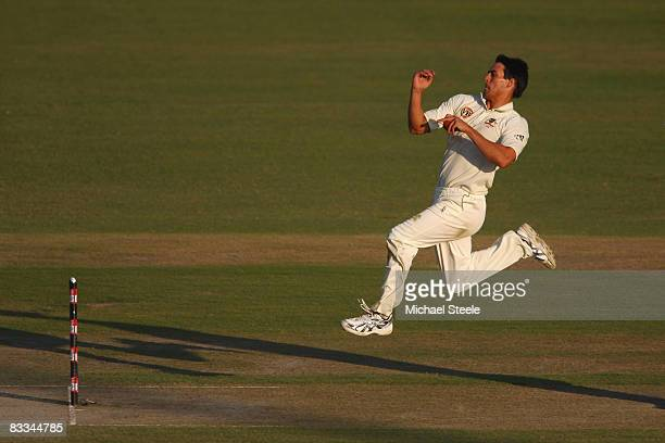 Mitchell Johnson of Australia bowls during day three of the Second Test match between India and Australia at the Punjab Cricket Association Stadium...