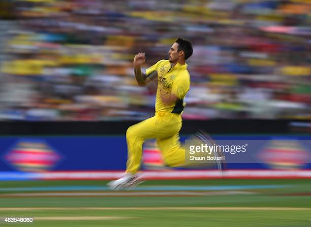 Mitchell Johnson of Australia bowls during the 2015 ICC Cricket World Cup match between England and Australia at Melbourne Cricket Ground on February...