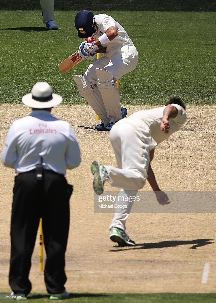 <a gi-track='captionPersonalityLinkClicked' href=/galleries/search?phrase=Mitchell+Johnson+-+Cricket+Player&family=editorial&specificpeople=665783 ng-click='$event.stopPropagation()'>Mitchell Johnson</a> of Australia bowls the ball and hits <a gi-track='captionPersonalityLinkClicked' href=/galleries/search?phrase=Virat+Kohli&family=editorial&specificpeople=4880246 ng-click='$event.stopPropagation()'>Virat Kohli</a> of India on the helmet during day three of the First Test match between Australia and India at Adelaide Oval on December 11, 2014 in Adelaide, Australia.