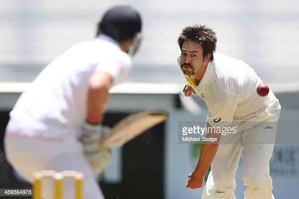 Mitchell Johnson of Australia bowls to Joe Root of England during day one of the Fourth Ashes Test Match between Australia and England at Melbourne...