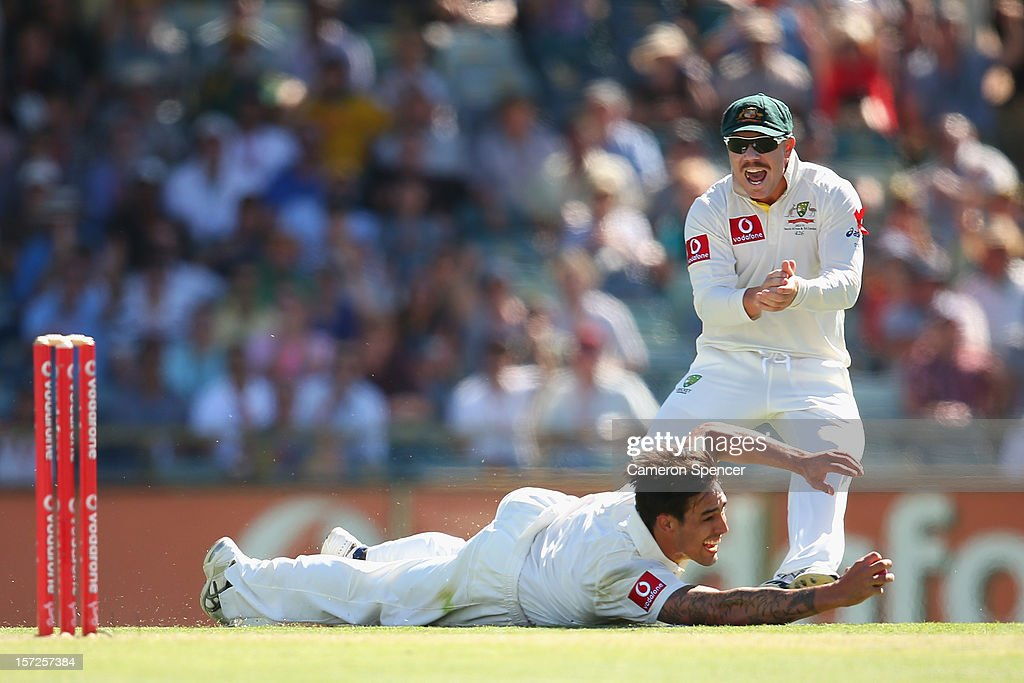 Mitchell Johnson of Australia catches out Alviro Petersen of South Africa off his own delivery during day two of the Third Test Match between Australia and South Africa at the WACA on December 1, 2012 in Perth, Australia.