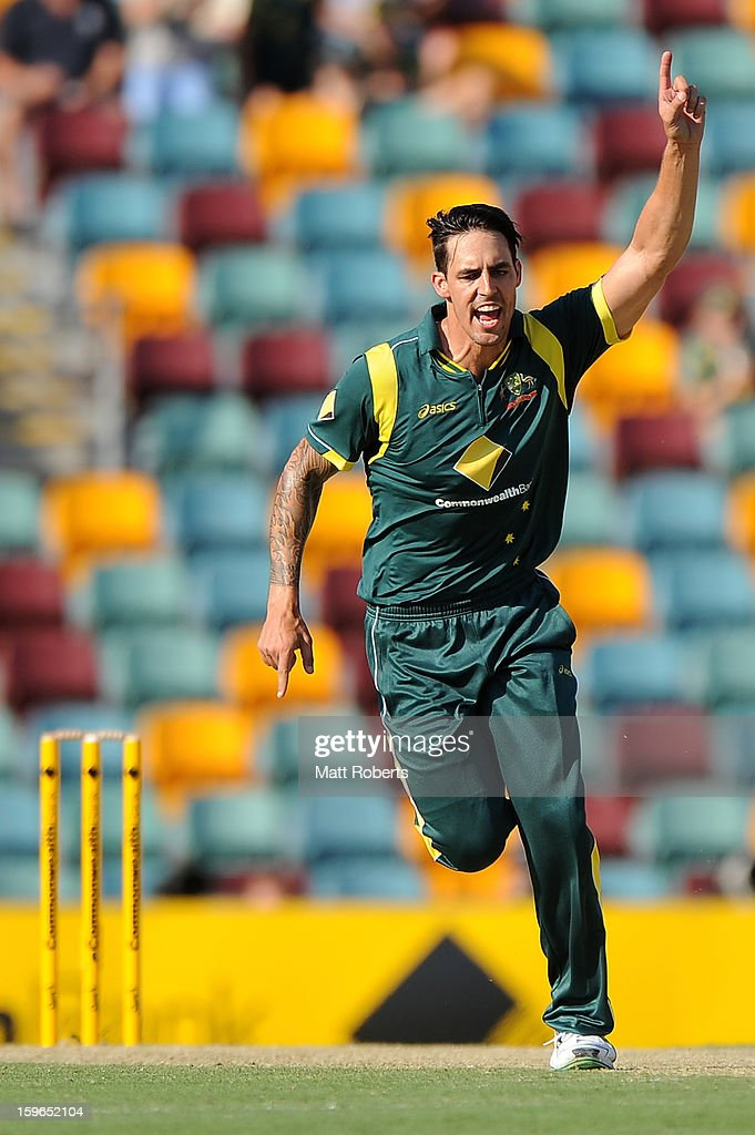 Mitchell Johnson of Australia celebrates a wicket during game three of the Commonwealth Bank one day international series between Australia and Sri Lanka at The Gabba on January 18, 2013 in Brisbane, Australia.