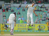 Mitchell Johnson of Australia celebrates after bowling Cheteshwar Pujara of India during day five of the Third Test match between Australia and India...