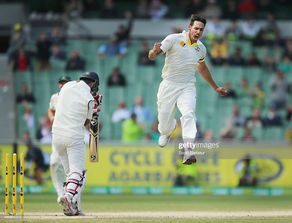 <a gi-track='captionPersonalityLinkClicked' href=/galleries/search?phrase=Mitchell+Johnson+-+Cricket+Player&family=editorial&specificpeople=665783 ng-click='$event.stopPropagation()'>Mitchell Johnson</a> of Australia celebrates after bowling <a gi-track='captionPersonalityLinkClicked' href=/galleries/search?phrase=Cheteshwar+Pujara&family=editorial&specificpeople=815522 ng-click='$event.stopPropagation()'>Cheteshwar Pujara</a> of India during day five of the Third Test match between Australia and India at Melbourne Cricket Ground on December 30, 2014 in Melbourne, Australia.