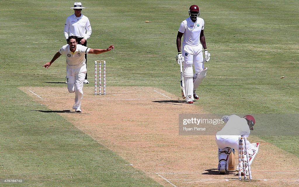 Mitchell Johnson of Australia celebrates after bowling Denesh Ramdin of West Indies during day one of the First Test match between Australia and the West Indies at Windsor Park on June 3, 2015 in Roseau, Dominica.
