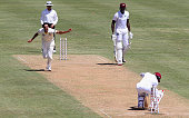 Mitchell Johnson of Australia celebrates after bowling Denesh Ramdin of West Indies during day one of the First Test match between Australia and the...