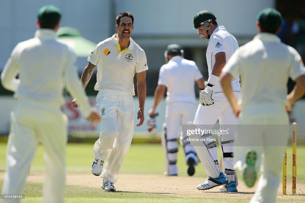 Mitchell Johnson (L) of Australia celebrates after bowling out <a gi-track='captionPersonalityLinkClicked' href=/galleries/search?phrase=Graeme+Smith+-+Cricket+Player&family=editorial&specificpeople=193816 ng-click='$event.stopPropagation()'>Graeme Smith</a> (R) of South Africa during day three of the Second Test match between South Africa and Australia at AXXESS St George's Cricket Stadium on February 22, 2014 in Port Elizabeth, South Africa.