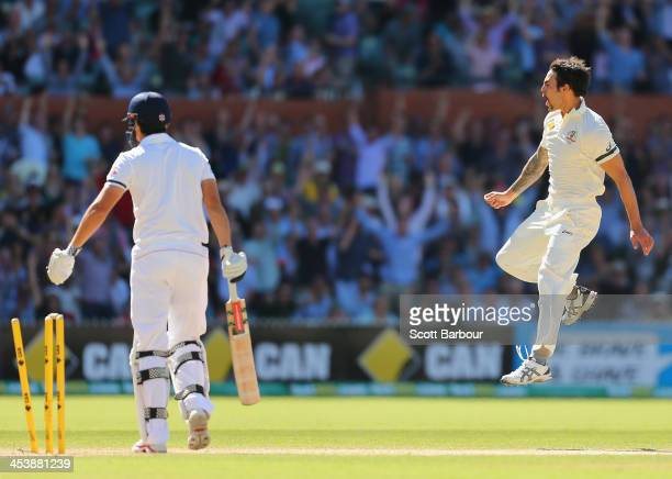 Mitchell Johnson of Australia celebrates after dismissing Alastair Cook of England during day two of the Second Ashes Test Match between Australia...