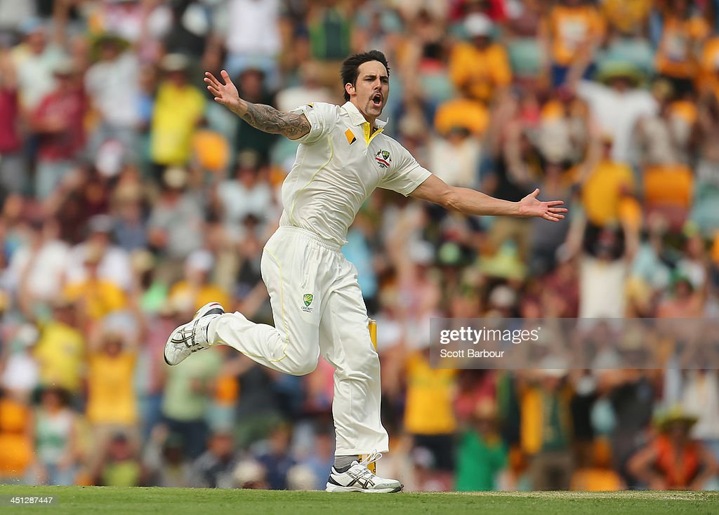 Mitchell Johnson of Australia celebrates after dismissing <a gi-track='captionPersonalityLinkClicked' href=/galleries/search?phrase=Joe+Root&family=editorial&specificpeople=6688996 ng-click='$event.stopPropagation()'>Joe Root</a> of England during day two of the First Ashes Test match between Australia and England at The Gabba on November 22, 2013 in Brisbane, Australia.