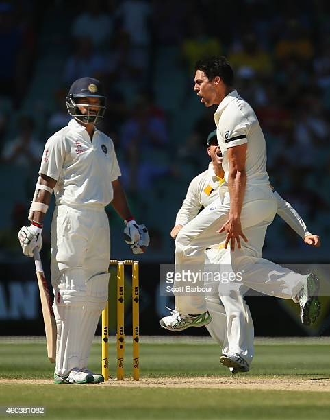 Mitchell Johnson of Australia celebrates after dismissing Shikhar Dhawan of India during day five of the First Test match between Australia and India...