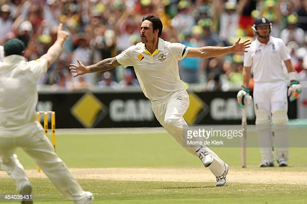 Mitchell Johnson of Australia celebrates after getting the wicket of Stuart Broad of England during day three of the Second Ashes Test match between...
