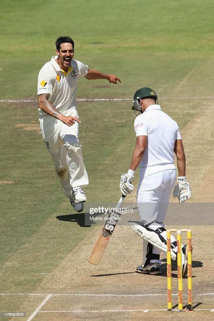 Mitchell Johnson of Australia celebrates after getting the wicket of <a gi-track='captionPersonalityLinkClicked' href=/galleries/search?phrase=Alviro+Petersen&family=editorial&specificpeople=4969996 ng-click='$event.stopPropagation()'>Alviro Petersen</a> of South Africa during day 3 of the third test match between South Africa and Australia at Sahara Park Newlands on March 3, 2014 in Cape Town, South Africa.