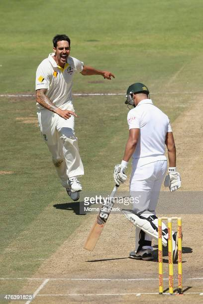 Mitchell Johnson of Australia celebrates after getting the wicket of Alviro Petersen of South Africa during day 3 of the third test match between...