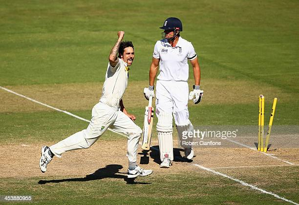 Mitchell Johnson of Australia celebrates after he took the wicket of Alastair Cook of England during day two of the Second Ashes Test Match between...