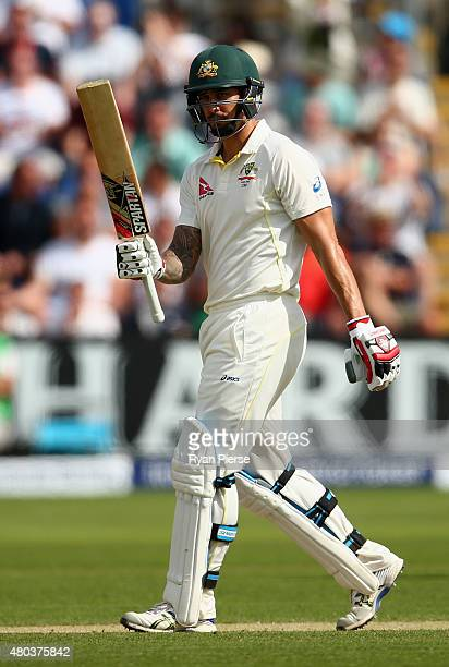Mitchell Johnson of Australia celebrates after reaching his half century during day four of the 1st Investec Ashes Test match between England and...