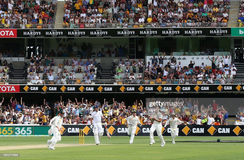 Mitchell Johnson of Australia celebrates after taking the wicket of <a gi-track='captionPersonalityLinkClicked' href=/galleries/search?phrase=Graeme+Swann&family=editorial&specificpeople=578767 ng-click='$event.stopPropagation()'>Graeme Swann</a> of England during day two of the First Ashes Test match between Australia and England at The Gabba on November 22, 2013 in Brisbane, Australia.