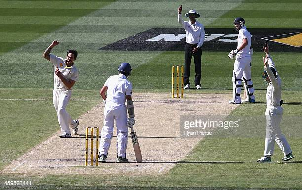 Mitchell Johnson of Australia celebrates after taking the wicket of Monty Panesar of England during day three of the Fourth Ashes Test Match between...