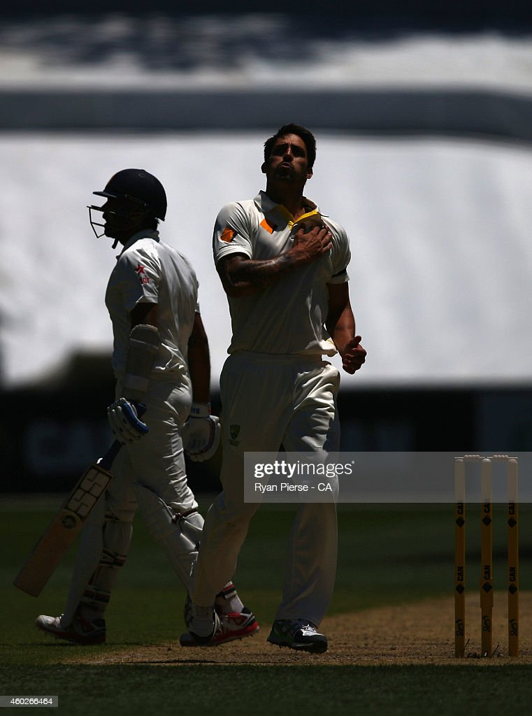 <a gi-track='captionPersonalityLinkClicked' href=/galleries/search?phrase=Mitchell+Johnson+-+Cricket+Player&family=editorial&specificpeople=665783 ng-click='$event.stopPropagation()'>Mitchell Johnson</a> of Australia celebrates after taking the wicket of <a gi-track='captionPersonalityLinkClicked' href=/galleries/search?phrase=Murali+Vijay&family=editorial&specificpeople=5592328 ng-click='$event.stopPropagation()'>Murali Vijay</a> of India during day three of the First Test match between Australia and India at Adelaide Oval on December 11, 2014 in Adelaide, Australia.