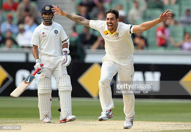 Mitchell Johnson of Australia celebrates after taking the wicket of Cheteshwar Pujara of India during day five of the Third Test match between...