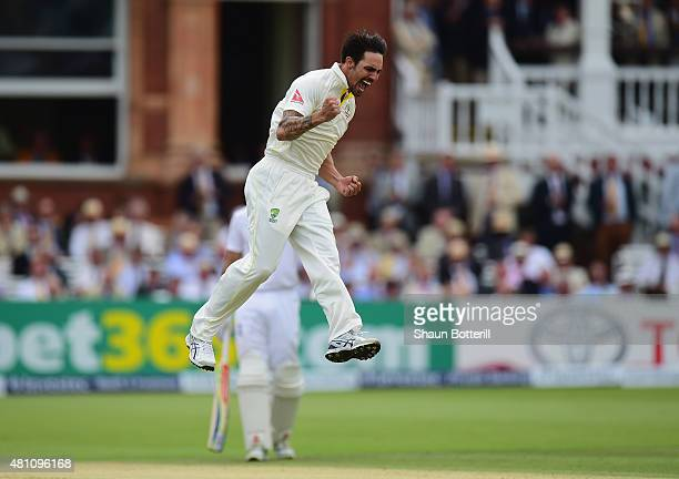 Mitchell Johnson of Australia celebrates after taking the wicket of Joe Root of England during day two of the 2nd Investec Ashes Test match between...