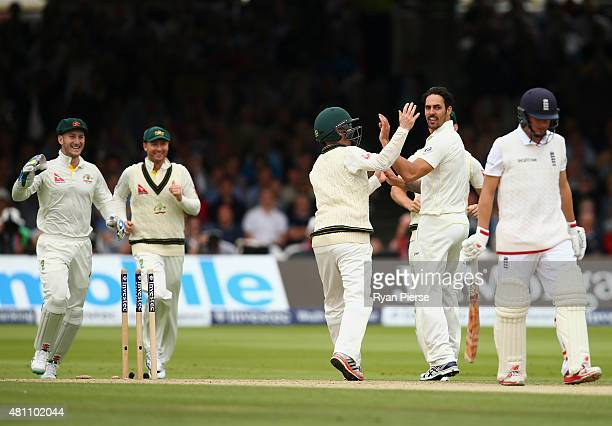 Mitchell Johnson of Australia celebrates after taking the wicket of Gary Ballance of England during day two of the 2nd Investec Ashes Test match...
