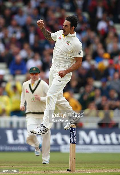 Mitchell Johnson of Australia celebrates after taking the wicket of Jonny Bairstow of England which was his 300th Test wicket during day two of the...