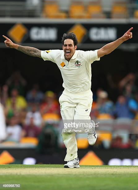 Mitchell Johnson of Australia celebrates after taking the wicket of Brendon McCullum of New Zealand during day two of the First Test match between...