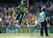 Mitchell Johnson of Australia celebrates bowling out England captain Eoin Morgan during the final match of the Carlton Mid One Day International...