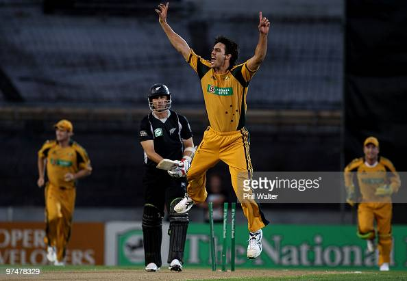 Mitchell Johnson of Australia celebrates bowling Shane Bond of New Zealand during the Second One Day International match between New Zealand and...