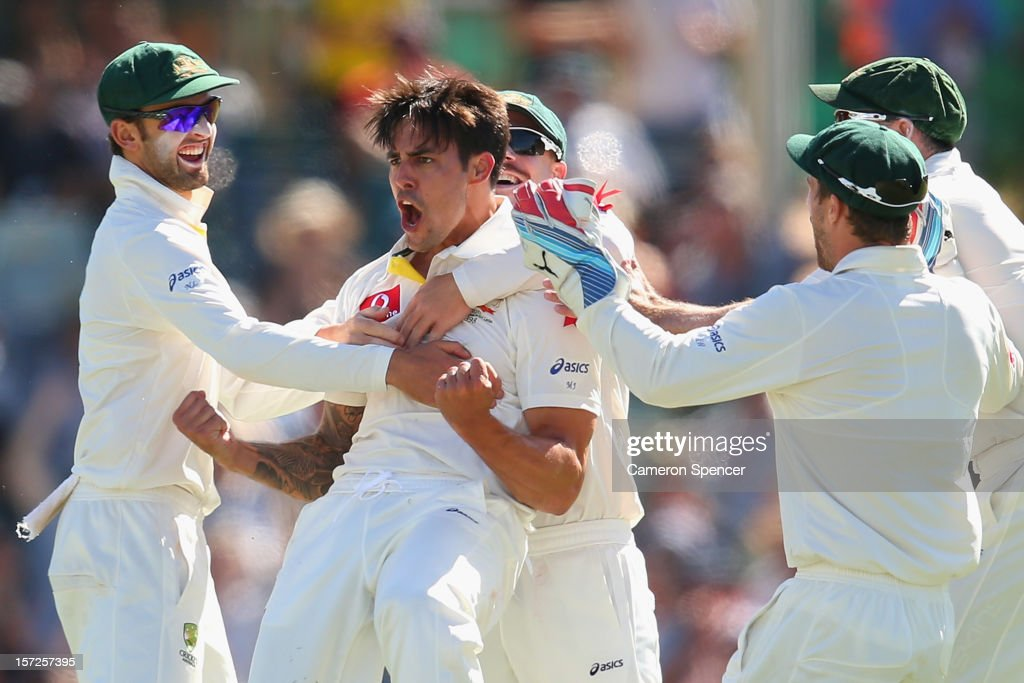 Mitchell Johnson of Australia celebrates catching out Alviro Petersen of South Africa off his own delivery during day two of the Third Test Match between Australia and South Africa at the WACA on December 1, 2012 in Perth, Australia.