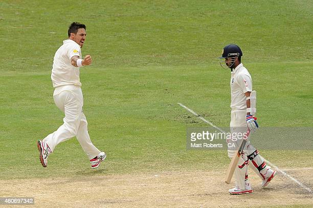 Mitchell Johnson of Australia celebrates dismissing Ajinkya Rahane of India during day four of the 2nd Test match between Australia and India at The...