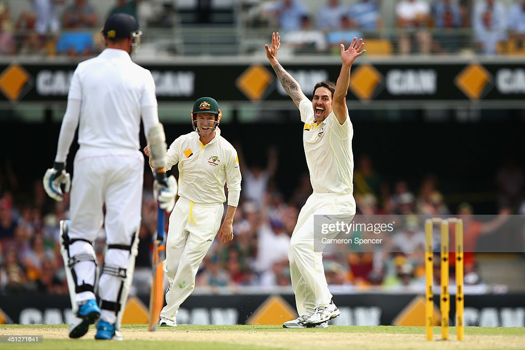 Mitchell Johnson of Australia celebrates dismissing Graeme Swann of England during day two of the First Ashes Test match between Australia and England at The Gabba on November 22, 2013 in Brisbane, Australia.