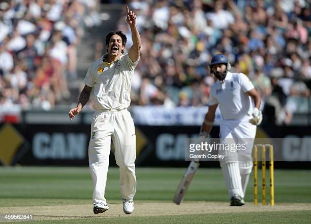 Mitchell Johnson of Australia celebrates dismissing Monty Panesar of England during day three of the Fourth Ashes Test Match between Australia and...