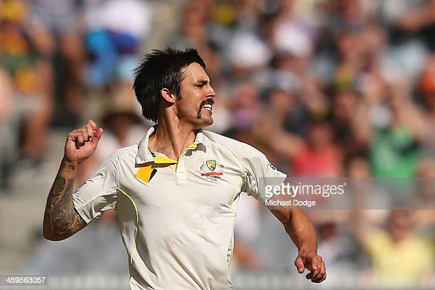 Mitchell Johnson of Australia celebrates his dismissal of Monty Panesar of England during day three of the Fourth Ashes Test Match between Australia...