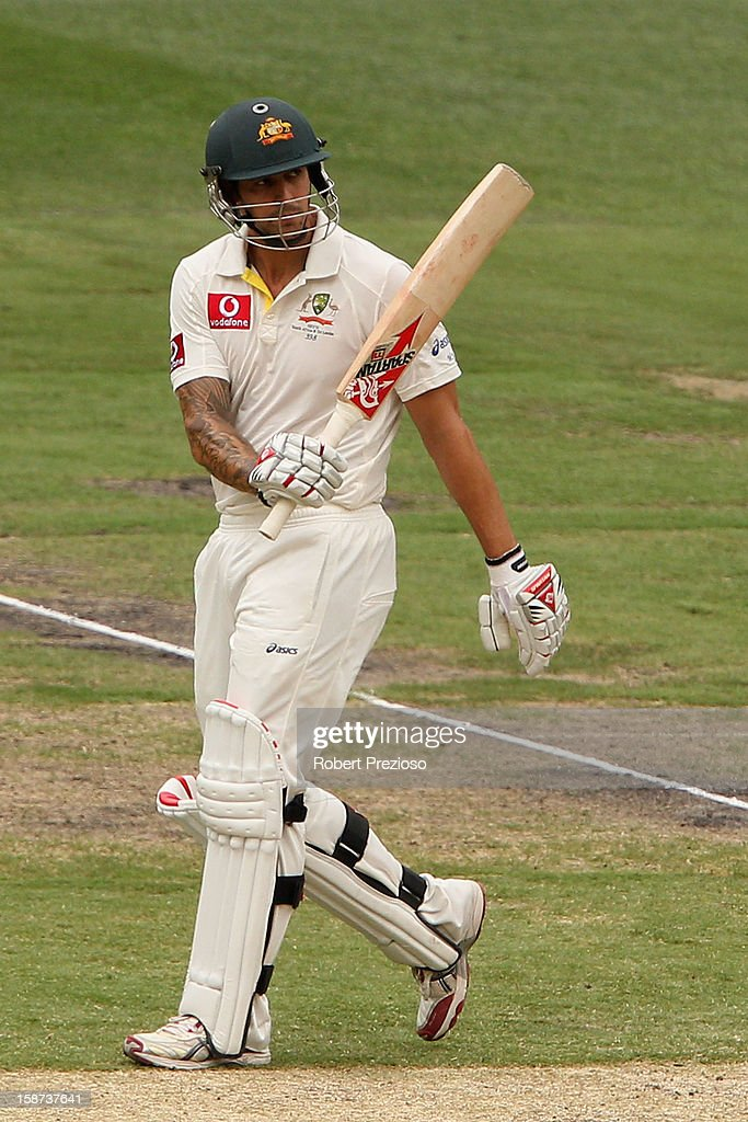 Mitchell Johnson of Australia celebrates his half century during day two of the Second Test match between Australia and Sri Lanka at Melbourne Cricket Ground on December 27, 2012 in Melbourne, Australia.