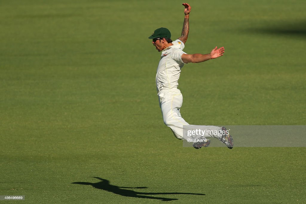 Mitchell Johnson of Australia celebrates taking a catch to dismiss Kevin Pietersen of England during day two of the Third Ashes Test Match between Australia and England at the WACA on December 14, 2013 in Perth, Australia.
